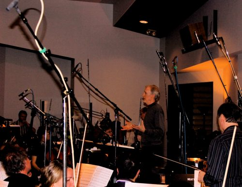 """Composer Mark McKenzie speaking to orchestra before recording the music to """"The ULtimate Life """""""